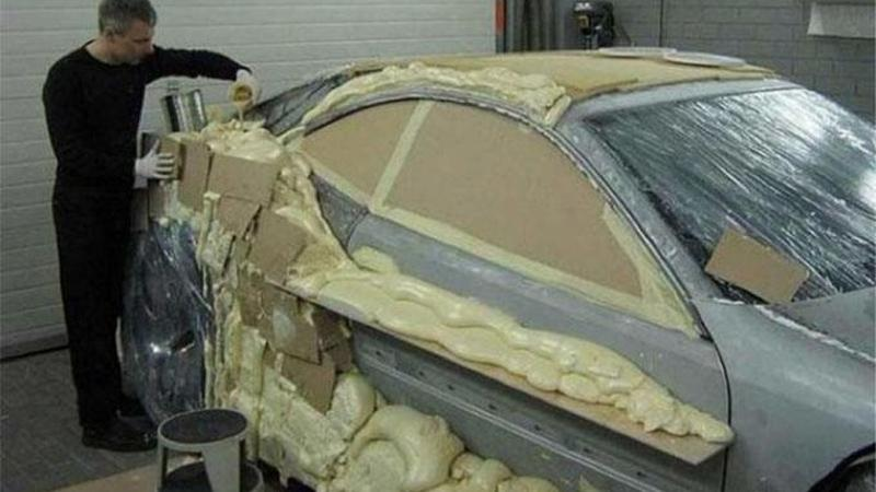 Man coats his car with polyurethane foam to transform it
